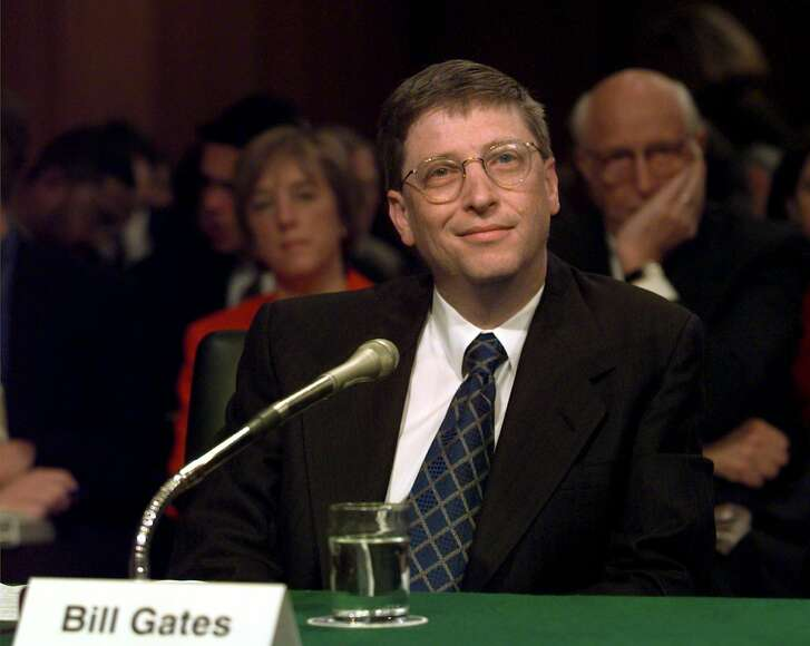 """Microsoft President Bill Gates prepares to testify on Capitol Hill Tuesday, March 3, 1998, before the Senate Judiciary Committee hearing on anti-competitive issues and technology. Gates said the computer software industry """"is working well on its own,'' without government interference. But he conceded that the government must police the market against """"collusion or other plainly illegal activities.''    (AP Photo/Joe Marquette)"""