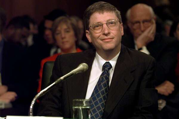 "Microsoft President Bill Gates prepares to testify on Capitol Hill Tuesday, March 3, 1998, before the Senate Judiciary Committee hearing on anti-competitive issues and technology. Gates said the computer software industry ""is working well on its own,'' without government interference. But he conceded that the government must police the market against ""collusion or other plainly illegal activities.''    (AP Photo/Joe Marquette)"