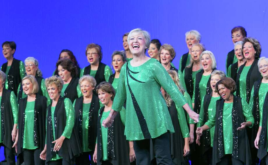 Members of The Woodlands Show Chorus, an organization of more than 70 female barbershop singers, with director Betty Clipman. The Woodlands Show Chorus invites all to preview a Zoom performance of its entry in the Sweet Adelines 75th Worldwide Competition in St. Louis Oct. 11-16, 2021, according to Brenda Anderson, member and publicist. The preview is on Oct. 12. Photo: Courtesy Photo