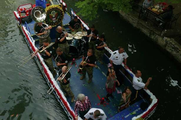 The Ft. Sam Houston float passes beneath the Commerce Street bridge during the Armed Forces River Parade on the Riverwalk on Saturday, May 20, 2017. Loretta Swit, who played Major Margaret Houlihan on the television show M*A*S*H, was the grand marshal of the event, which featured 26 military-themed floats.