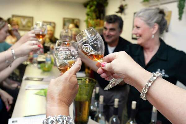 Guests make a toast before sampling the raisin wine during the Tacky Wine Tours stop at Bruno & George Winery in Sour Lake.  Photo taken Saturday 5/12/18 Ryan Pelham/The Enterprise