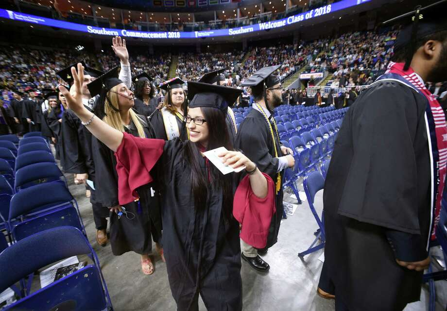 Benazir Safi waves to family at Southern Connecticut State University's undergraduate commencement exercises at Webster Bank Arena in Bridgeport on May 18, 2018. Photo: Arnold Gold, Connecticut Hearst Media / New Haven Register