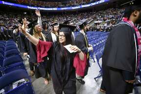 Benazir Safi waves to family at Southern Connecticut State University's undergraduate commencement exercises at Webster Bank Arena in Bridgeport on May 18, 2018.