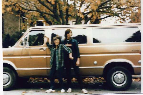 FILE-- Tanya Van Cuylenborg and Jay Cook with the van they drove to the United States, a bronze 1977 Ford Club wagon. Thirty years after the murders of a young Canadian couple, scientific advances, a family tree and a paper cup have led to an arrest in the case.