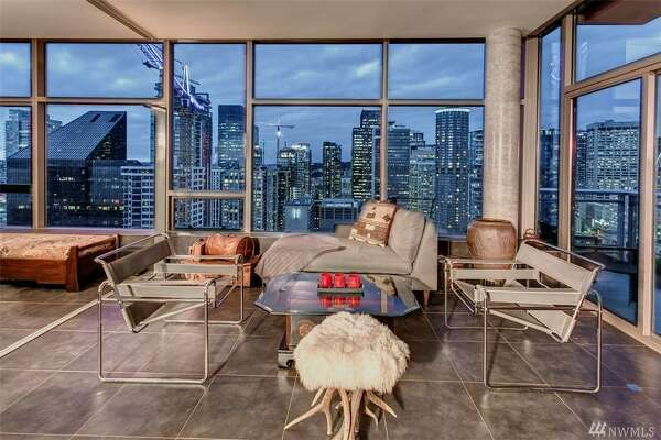 Glittery glass box in the sky: this swanky penthouse in downtown's Cristalla building asks $1.160M