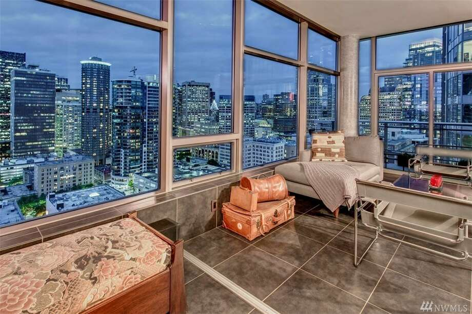 Glittery glass box in the sky: this swanky penthouse in downtown's Cristalla building asks $1.160M Photo: The Warmack Group