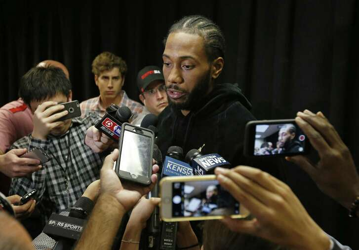 San Antonio Spurs forward Kawhi Leonard (2) answers questions from the media before the game with the Detroit Pistons Monday Dec. 4, 2017 at the AT&T Center.
