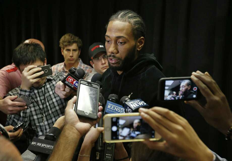 San Antonio Spurs forward Kawhi Leonard (2) answers questions from the media before the game with the Detroit Pistons Monday Dec. 4, 2017 at the AT&T Center. Photo: Edward A. Ornelas, Staff / San Antonio Express-News / © 2017 San Antonio Express-News