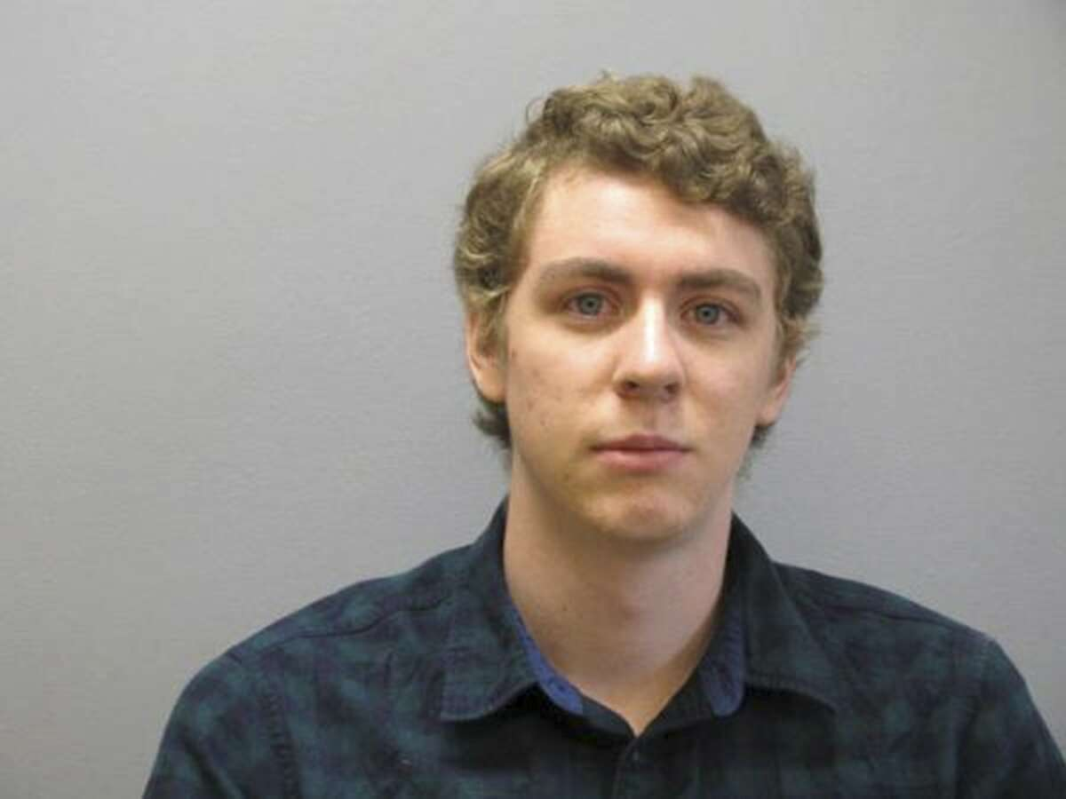 FILE - This Sept. 6, 2016 file photo released by the Greene County Sheriff's Office shows former Stanford University swimmer Brock Turner at the Greene County Sheriff's Office in Xenia, Ohio, where he officially registered as a sex offender. Judge Aaron Persky says he would handle the sexual assault case of Turner the same way today as he did almost exactly two years ago, even though it's the reason why he is the target of a June 5 recall election in Santa Clara County. Persky sentenced Turner to six months in jail. (Greene County Sheriff's Office via AP, file)