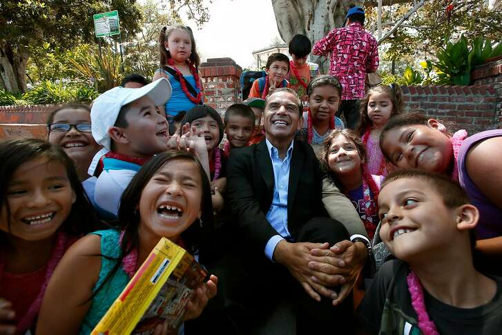 Out going Los Angeles mayor Antonio Villaraigosa gets his photo taken with students from Hazeltine Avenue Elementary School while visiting Placita Olvera, one of many destination on his farewell tour of the city. Villaraigosa saw victory and defeat during his roller-coaster years as mayor of America's second-largest city. But experts agree he won more than he lost.  (Photo by Irfan Khan/Los Angeles Times via Getty Images)