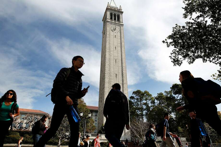 Students pass in front of the Campanile Tower on the Cal campus in Berkeley, CA Wednesday, February 11, 2016. Photo: Michael Short / Special To The Chronicle 2016