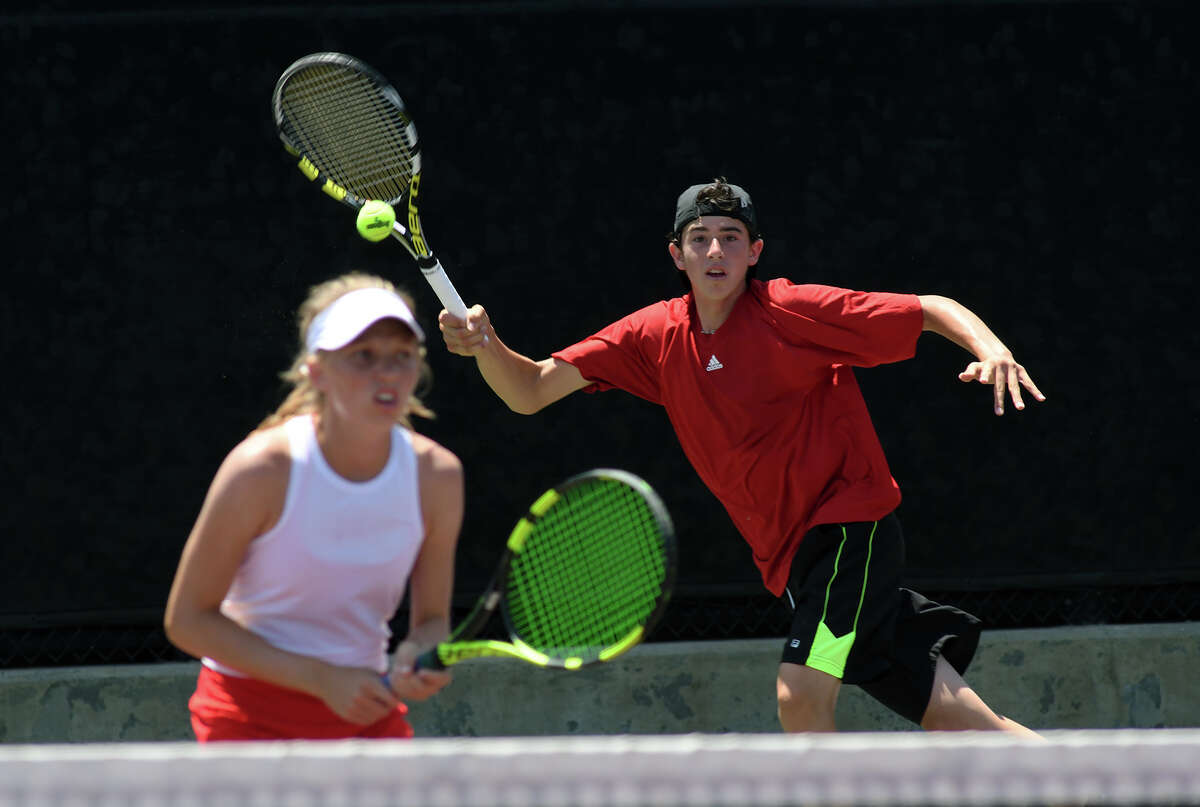 Houston Memorial High School senior Andrew Esses, right, plays a forehand behind partner Drew Morris, a freshman, during their Class 6A Mixed Doubles Finals match against the team from Austin Lake Travis at the 2017-2018 UIL State Tennis Championships at the George P. Mitchell Tennis Center on the campus of Texas A&M University in College Station on May 18, 2018.