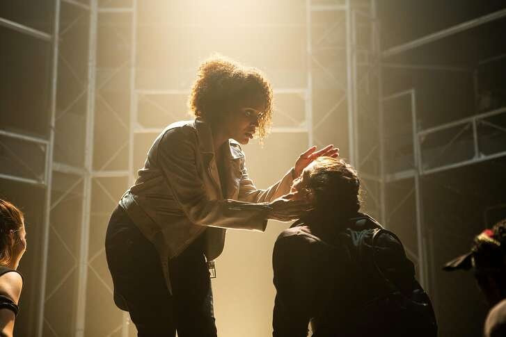 """From left:�Janelle LaSalle as Jesus and�Madeline Lambie as an apostle in Ray of Light Theatre's """"Jesus Christ Superstar."""""""