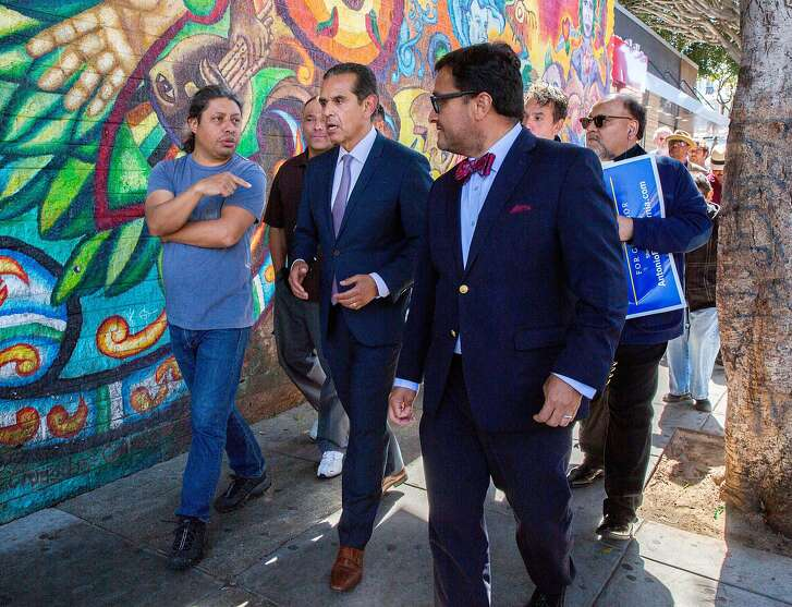 Democratic gubernatorial candidate and former Los Angeles Mayor Antonio Villaraigosa (center) walks with pedestrians and former member of the Board of Supervisors David Campos after a rally at Mission and 24th streets, Friday, May 11, 2018, in San Francisco, Calif. Villaraigosa earlier accepted an endorsement from Art Agnos, a former mayor of San Francisco.