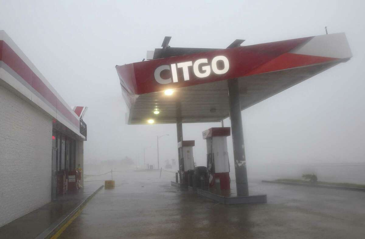 The roof of a gas station on Galveston's Seawall Boulevard sways during Hurricane Harvey.