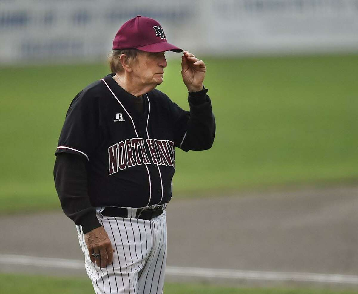 North Haven baseball coach Bob DeMayo gives a sign to the batter in the CIAC Class L championship game against Foran on June 10.