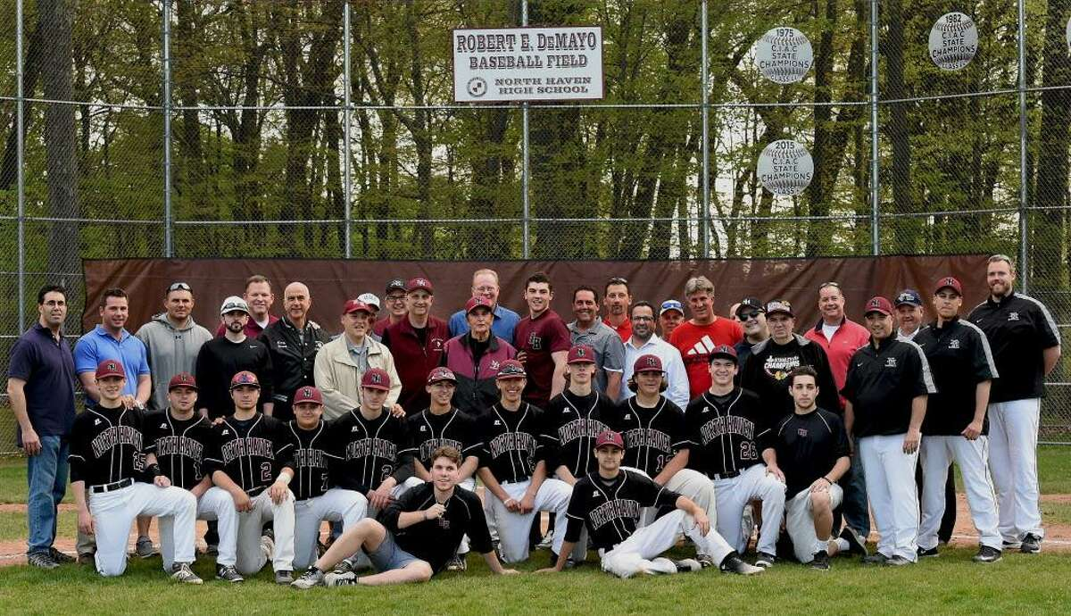 Coach Bob DeMayo, center, is photographed with members of North Haven's five state championship teams, from 1975, 1982, 1985, 2003 and 2015, on May 11, 2016, at a pregame ceremony at the Robert E. DeMayo Baseball Field in North Haven.