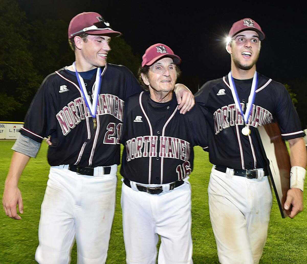 Coach Bob DeMayo walks across the outfield with Richie DePalma, left, and Nick Proto after their 3-2 win over East Lyme for the Class L state championship June 13, 2015.