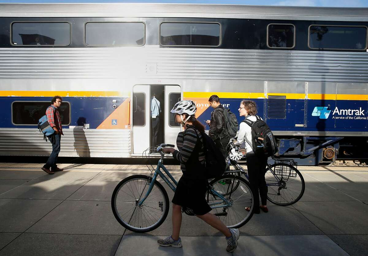 Commuters prepare to board a westbound Capitol Corridor train at the Amtrak station in Berkeley, Calif. on Thursday, May 10, 2018. Improvements to the Capitol Corridor's infrastructure would be upgraded if voters approve Regional Measure 3 which would raise area bridge tolls, except on the Golden Gate Bridge, which would fund transportation projects throughout the Bay Area.