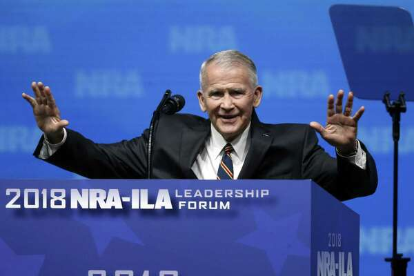 Former U.S. Marine Lt. Col. Oliver North acknowledges attendees at the recent National Rifle Association-Institute for Legislative Action Leadership Forum in Dallas. The NRA announced NRA president of the National Rifle. A reader condemns North for comments he made about gun control activists.