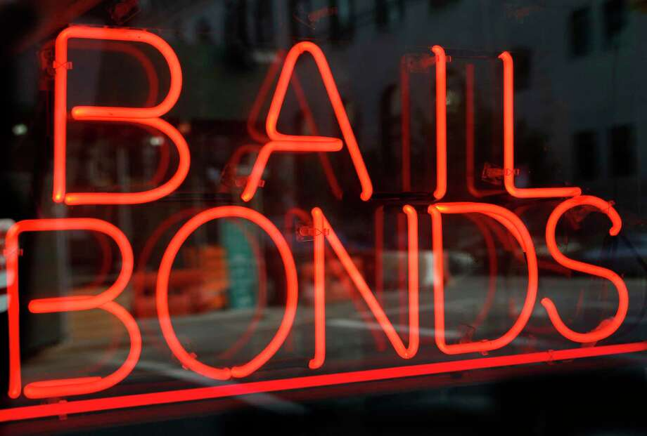 Getting one of these — a bail bond — has been out of reach for the many indigents jailed in Bexar County. Beginning Oct. 1, they will at least be given counsel at their bail hearings. Photo: Kathy Willens /Associated Press / Copyright 2018 The Associated Press. All rights reserved.