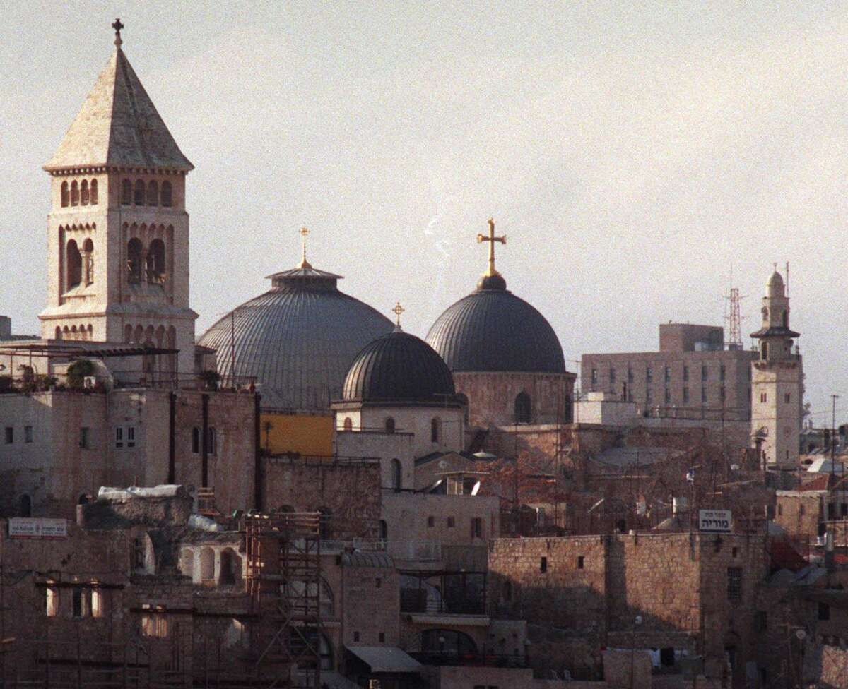 The dome of the Church of the Holy Sepulchre in Jerusalem, right, is surrounded by other churches and minarets dotting the city skyline in 1999. The city is the natural and obvious capital of Israel.