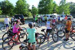 Cyclists gather in the parking lot at Rob Fleming Park on Wednesday, May 16, for the inaugural Ride of Silence in The Woodlands.
