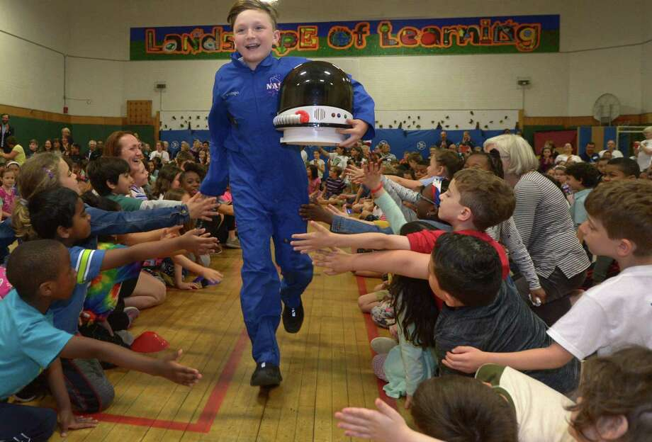 Payload Specialist Nico Restrepo is introduced during the culmination of Columbus Magnet School's Young Astronaut 23rd mission Friday, May 18, 2018, at the school in Norwalk, Conn. Photo: Erik Trautmann / Hearst Connecticut Media / Norwalk Hour