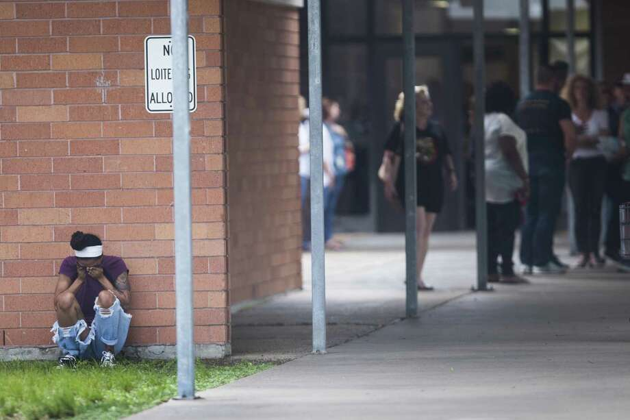 People gather by the Barnett Intermediate School where parents are gathering to pick up their children following a shooting at Santa Fe High School Friday, May 18, 2018, in Santa Fe, Texas. Photo: Marie D. De Jesus, MBO / Associated Press / ' 2018 Houston Chronicle
