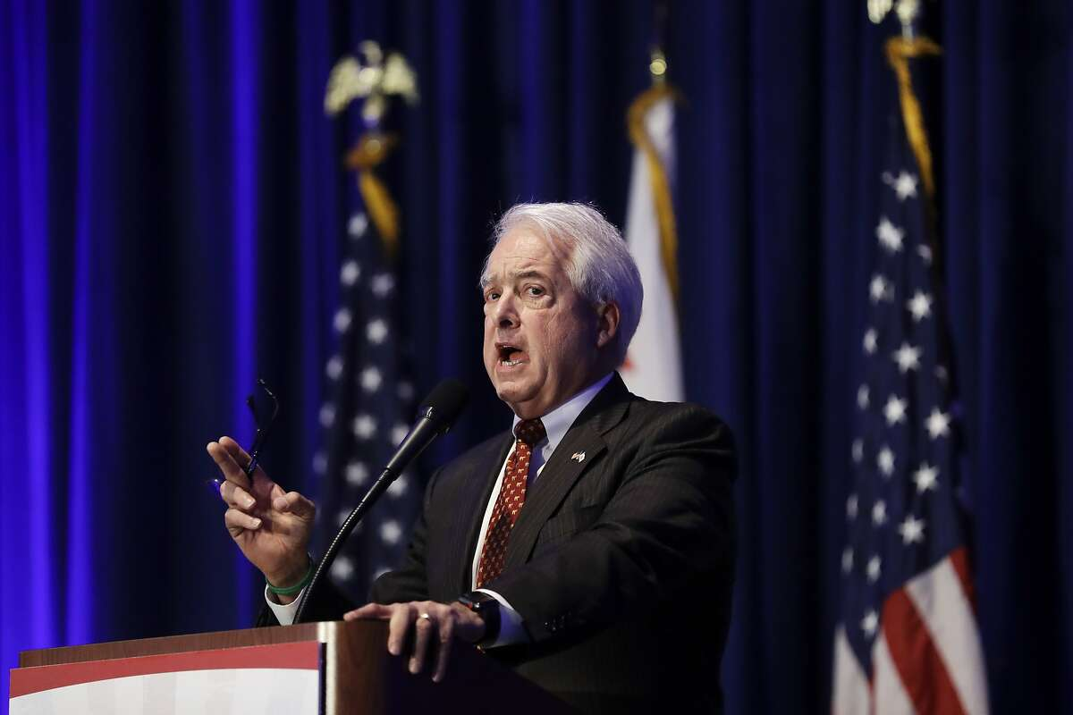 File - In this May 5, 2018 file photo, California gubernatorial candidate John Cox speaks during the California Republican Party convention in San Diego. President Donald Trump is backing San Diego businessman Cox for California governor. Trump announced his endorsement on Twitter Friday, May 18, saying he looks forward to working with Cox to