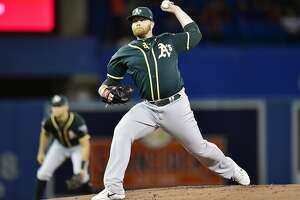 Oakland Athletics starting pitcher Brett Anderson delivers against the Toronto Blue Jays during first-inning baseball game action in Toronto, Friday, May 18, 2018. (Frank Gunn/The Canadian Press via AP)