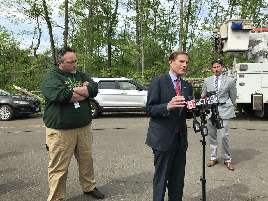 U.S. Sen. Richard Blumenthal says Friday he will push to get federal funding for relief efforts in Hamden after a tornado. Behind him are Hamden Mayor Curt Leng and Police Chief Thomas Wydra. Photo: Brian Zahn/Hearst Connecticut Media