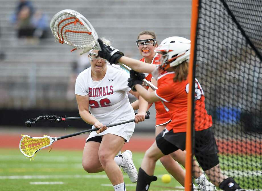 Greenwich Jen Kelly strikes from the crease scoring on Ridgefield goalie Lexi Held in a FCIAC girls lacrosse quarterfinal game at Cardinal Stadium in Greenwich, Conn. on May 18, 2017. Greenwich defeats Ridgefield 13-8 to advance to next weeks semifinals. Photo: Matthew Brown / Hearst Connecticut Media / Stamford Advocate