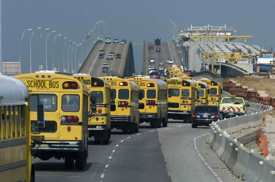 Galveston Independent School District buses carried evacuees north on Interstate 45 as Hurricane Rita approached. Photo: KEVIN BARTRAM, MBR / AP / THE GALVESTON COUNTY DAILY NEWS
