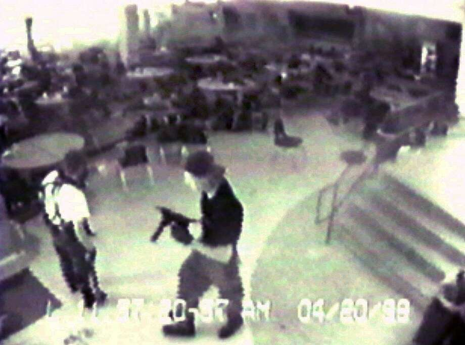 In this April 20, 1999 file photo Eric Harris, left, and Dylan Klebold, carrying a TEC-9 semi-automatic pistol, are seen in a photo made from a security camera image in the cafeteria at Columbine High School, in Littleton, Colo., during their shooting rampage which killed a teacher and 12 students. The mother of Columbine killer Dylan Klebold says she has been studying suicide in the decade since the high school massacre but had no idea her son was suicidal until she read his journals after his death.  (AP Photo/Jefferson County Sheriff's Department/File) Photo: Anonymous /AP / Associated Press