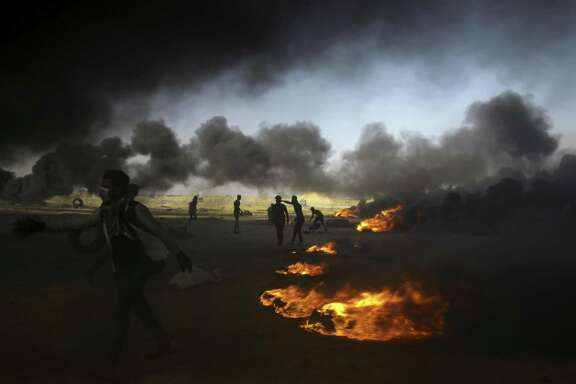 Palestinian protesters burn tires at the Gaza Strip's border with Israel, east of Khan Younis, on Tuesday, May 15. The aftershocks of the U.S. Embassy move to Jerusalem and bloodshed on the Gaza border are shaking up the region, including the relationship between Palestinian President Mahmoud Abbas and former his negotiating partners, Israel and the U.S.