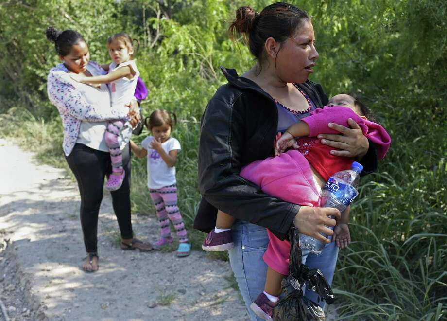 Patricia Rodriguez Hernandez, 22, holds her daughter, Denia Abigail, 1, after surrendering to U.S. Border Patrol agents near the Anzalduas International Bridge in Mission, Texas, Thursday, May 10, 2018. She was with a group of Honduran families that crossed the Rio Grande from Mexico earlier in the morning. Photo: JERRY LARA / San Antonio Express-News / San Antonio Express-News