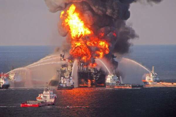 A file photo taken on April 21, 2010 shows a U.S. Coast Guard handout image of fire boat response crews as they battle the blazing remnants of the BP operated offshore oil rig, Deepwater Horizon, in the Gulf of Mexico.