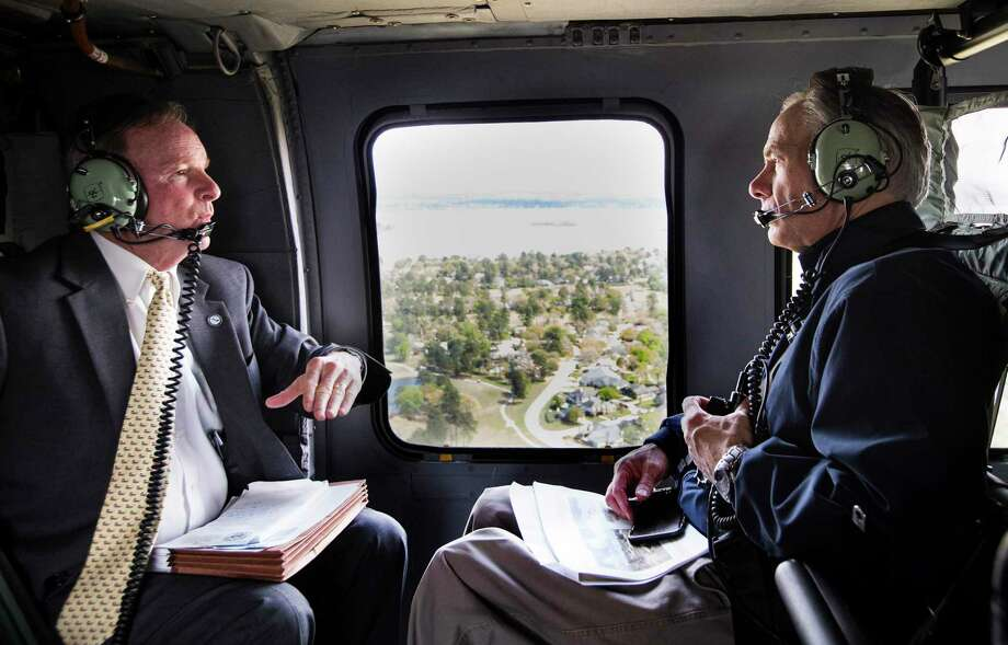 Gov. Greg Abbott, right, speaks with Dave Martin, the Houston city councilman representing heavily damaged Kingwood area during an aerial tour of neighborhoods devastated in the aftermath of Hurricane Harvey Photo: Brett Coomer, Staff / Houston Chronicle / © 2018 Houston Chronicle