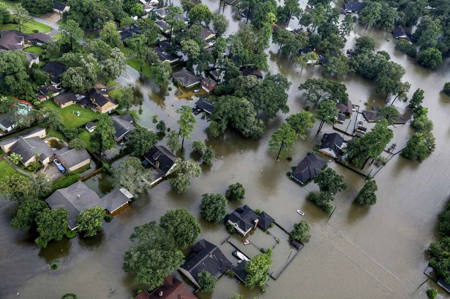 A neighborhood is inundated by floodwaters from Hurricane Harvey on Tuesday, Aug. 29, 2017, in Spring. Photo: Brett Coomer, Staff / Houston Chronicle / © 2017 Houston Chronicle