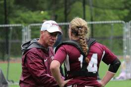 Hopkins catcher Jessica D'Errico talks with her coach during the FAA softball championship between St. Luke's and Hopkins at St. Luke's School in New Canaan, Conn on May 18, 2018. St. Luke's claimed its fourth-straight title 11-2.