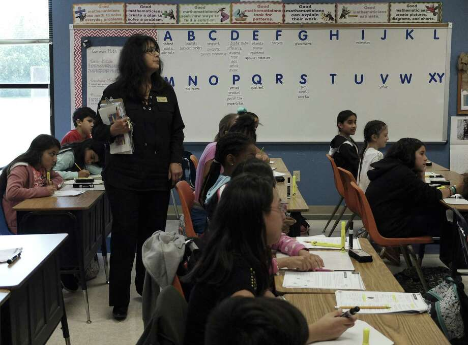 McQueeney Elementary Principal Yolanda Guerra observes a fifth-grade science class on Thursday, May 10, 2018. Houston-based nonprofit Children at Risk's 2018 school rankings, which highlight high-performing high-poverty schools, show that San Antonio is not closing the gap with the other big cities in Texas and SAISD in particular is not moving the needle fast enough. This year's featured school is McQueeney Elementary in Seguin ISD. (Kin Man Hui/San Antonio Express-News) Photo: Kin Man Hui, Staff / San Antonio Express-News / ©2018 San Antonio Express-News