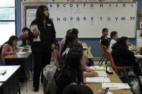 McQueeney Elementary Principal Yolanda Guerra observes a fifth-grade science class on Thursday, May 10, 2018. Houston-based nonprofit Children at Risk's 2018 school rankings, which highlight high-performing high-poverty schools, show that San Antonio is not closing the gap with the other big cities in Texas and SAISD in particular is not moving the needle fast enough. This year's featured school is McQueeney Elementary in Seguin ISD. (Kin Man Hui/San Antonio Express-News)