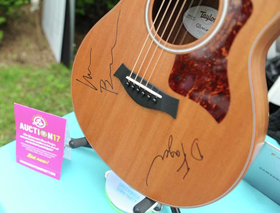 A guitar signed by Steely Dan to be auctioned off the 2017 Greenwich Town Party at Roger Sherman Baldwin Park in Greenwich, Conn. Saturday, May 27, 2017. The 2017 Town Party was headlined by classic jazz fusion group Steely Dan and American blues rock band Alabama Shakes. Several local bands also performed, with many activities for children and families and local food stands. Photo: Tyler Sizemore / Hearst Connecticut Media / Greenwich Time