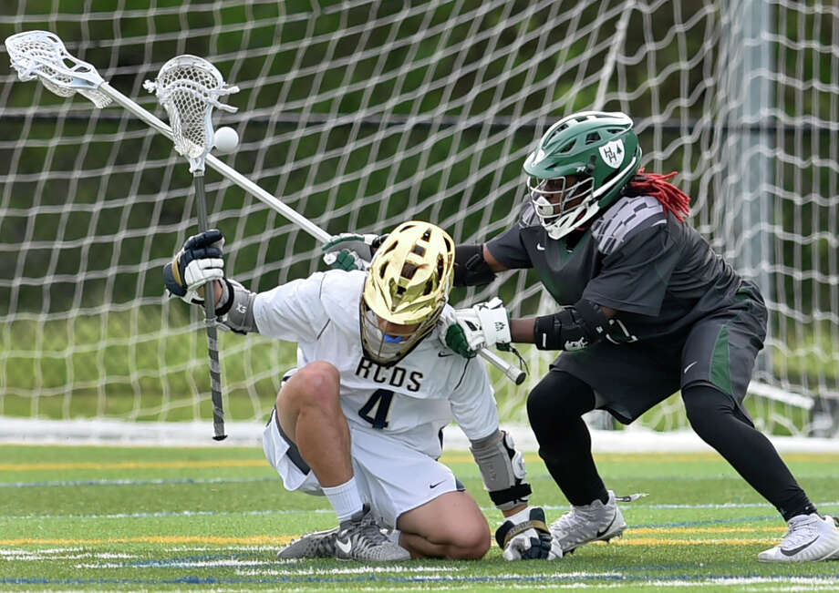 Hamden, Connecticut - Friday,  May 18, 2018: Nishan Dactwiler of Rye Country Day School loses the ball, left, against Konye Taylor of Hamden Hall during the second quarter of the  Fairchester Athletic Association championship Friday at Hamden Hall. Hamden Hall defeated Rye Country Day School 9-7. Photo: Peter Hvizdak, Hearst Connecticut Media / New Haven Register