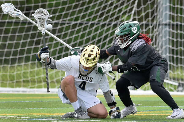 Hamden, Connecticut - Friday,  May 18, 2018: Nishan Dactwiler of Rye Country Day School loses the ball, left, against Konye Taylor of Hamden Hall during the second quarter of the  Fairchester Athletic Association championship Friday at Hamden Hall. Hamden Hall defeated Rye Country Day School 9-7.