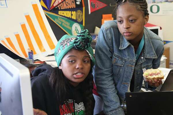 Senior Destiny Shabazz (left) talks with Brooke-Lynn Upshur (right) in  the college and career center at McClymonds High School on Friday, May 18, 2018 in Oakland, Calif.