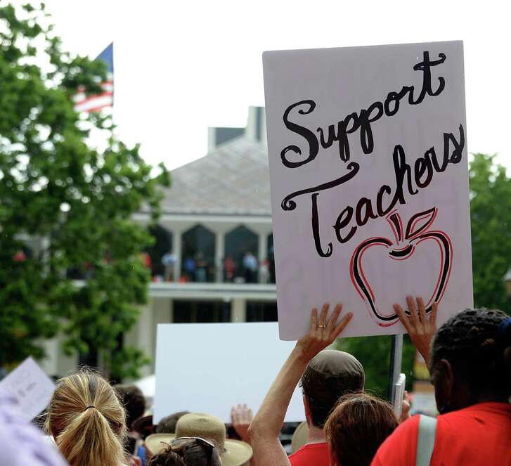 Crowds gather during the Rally for Respect outside the North Carolina Legislative Building on May 16, 2018 in Raleigh, North Carolina. Several North Carolina counties closed schools to allow teachers to march on the opening day of the General Assembly.