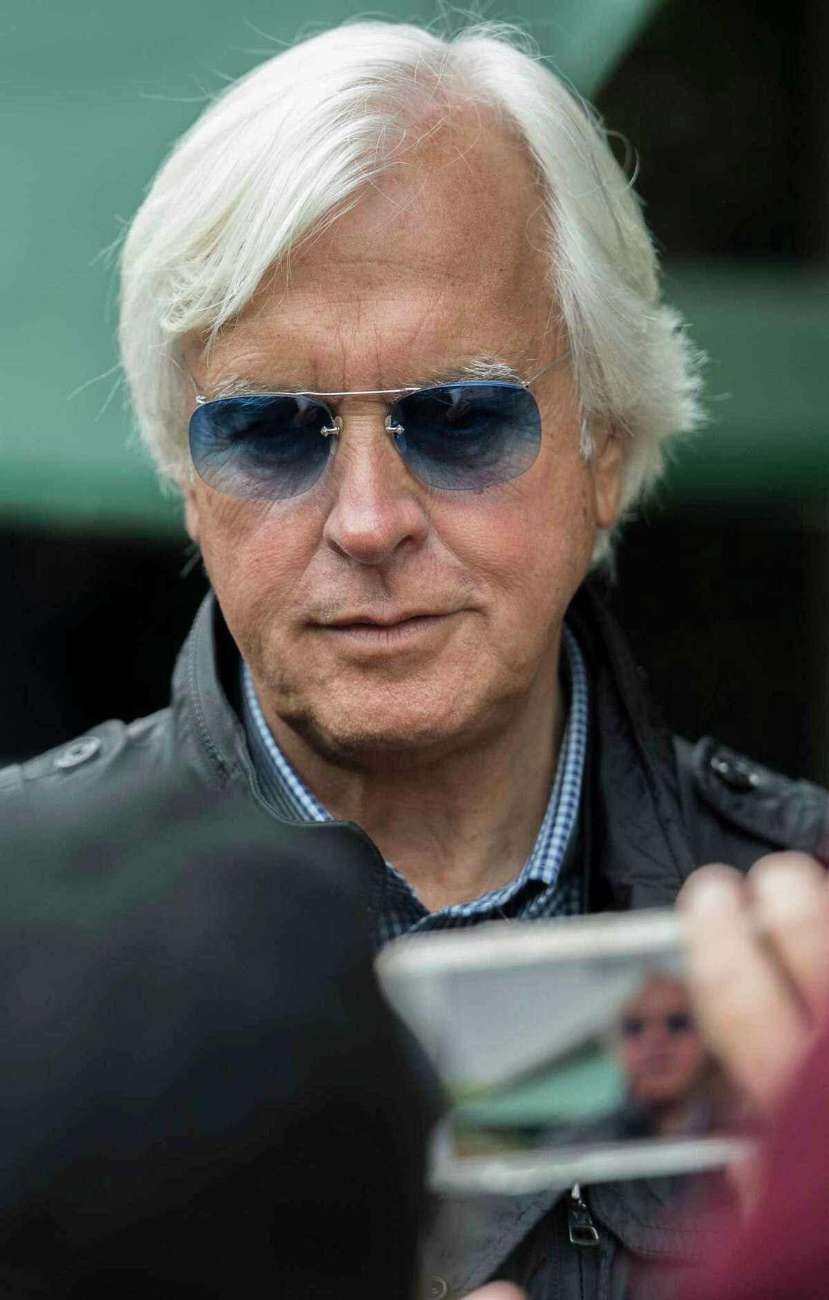 Justify's trainer Bob Baffert poses for a cell phone photo at the Pimlico Race Course on Preakness Day Friday May 18, 2018 in Baltimore, MD. (Skip Dickstein/Times Union)