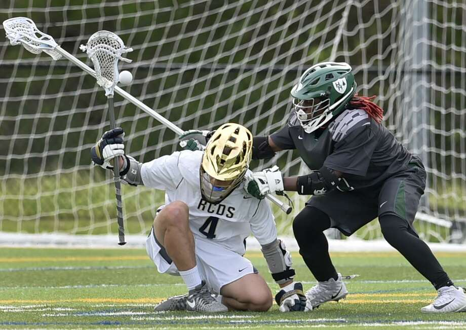Rye's Nishan Dactwiler, left, loses the ball against Hamden Hall's Konye Taylor during the second quarter of the Fairchester Athletic Association championship on Friday. Hamden Hall won 9-7. Photo: Peter Hvizdak / Hearst Connecticut Media / New Haven Register
